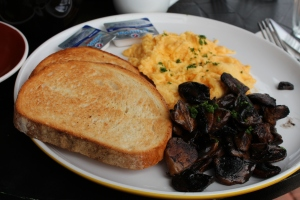 Scrambled eggs and mushrooms on sourdough toast