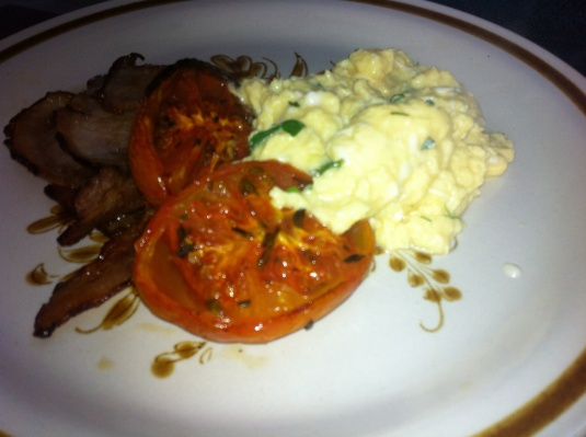 Scrambled eggs, nitrate free bacon and grilled tomato
