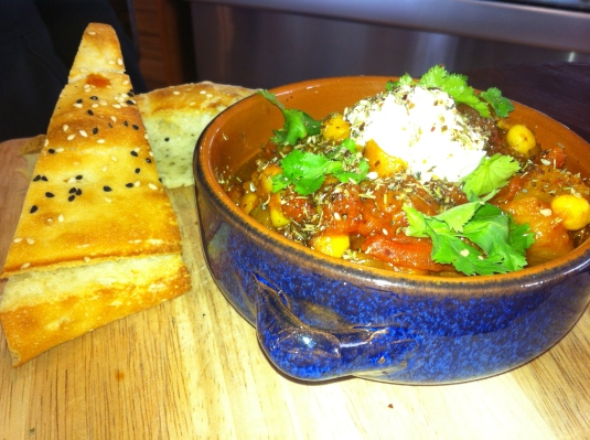 Pumpkin and chickpea guisado, baked turkish bread, labne and za'atar