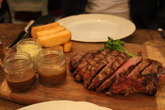 Grass Fed Dry Aged Rib Eye 600gm with pommes pont neuf and sauces